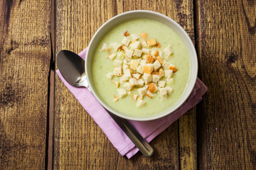 Broccoli cream soup and dried crusts, top view