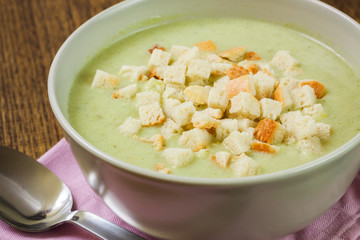 Broccoli cream soup and dried crusts, closeup