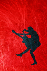 Silhouette of a woman with a guitar on a grunge, red background