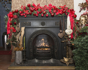 Christmas Stone fireplace with decorations, red and green