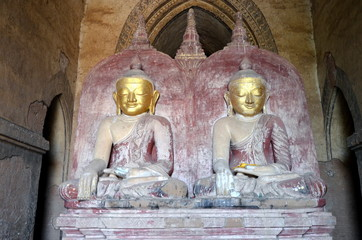 Two ancient golden Buddhas. 13th century. Bagan, Myanmar