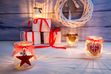 Glowing candles and gifts for Christmas