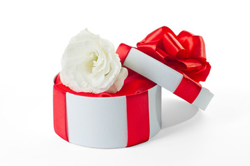 Round gift box with flower  isolated with clipping path