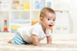 crawling baby boy indoors - 74709230