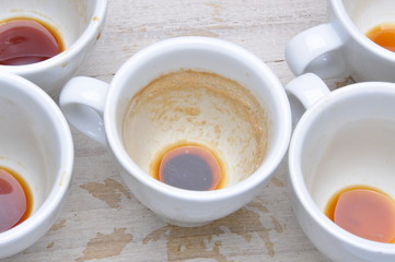 Dirty cups after coffee on the table