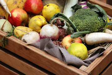 Box of raw fruits and vegetables from the market