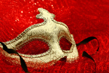 Vintage carnival mask in red background