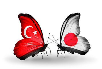 Two butterflies with flags Turkey and Japan