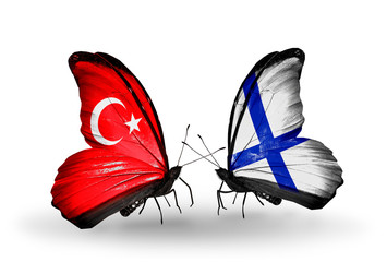 Two butterflies with flags Turkey and Finland