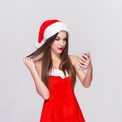 Woman taking selfie in christmas outfit