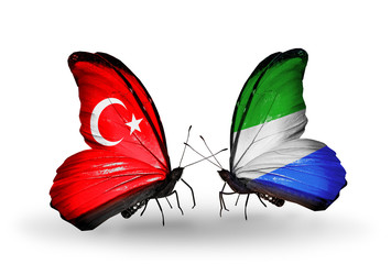 Two butterflies with flags Turkey and Sierra Leone