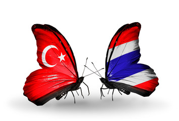 Two butterflies with flags Turkey and Thailand