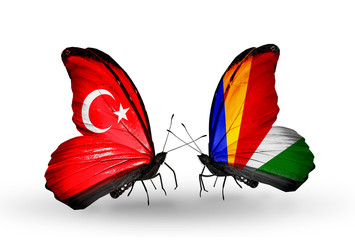 Two butterflies with flags Turkey and Seychelles