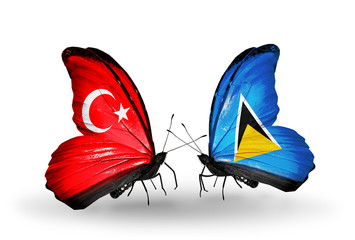 Two butterflies with flags Turkey and Saint Lucia