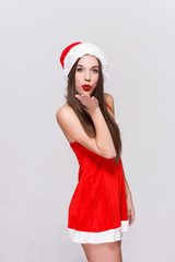 Santa woman with red lips sending kisses