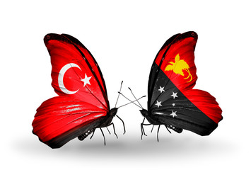 Two butterflies with flags Turkey and Papua New Guinea