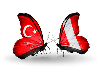 Two butterflies with flags Turkey and Peru