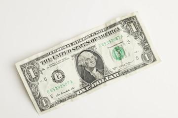 Rumpled one dollar bill