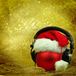 Christmas ball with headphones in glittering background - 74713095