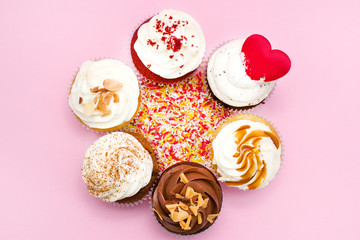 Six cupcakes on pink background
