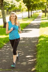 Fit blonde jogging in the park