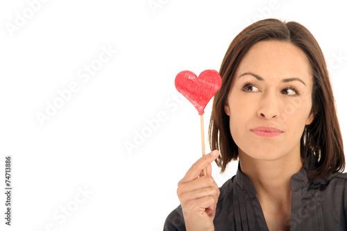 canvas print picture Frau hält ein Herz in der Hand