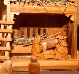 Nativity scene with Holy family in wood