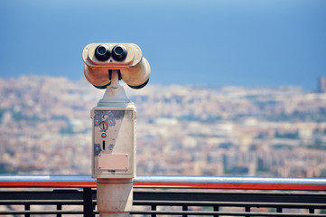 Touristic telescope with view of Barcelona, Spain