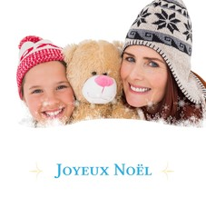 Composite image of mother and daughter holding teddy bear