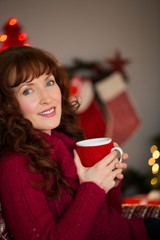 Portrait of pretty redhead enjoying hot drink