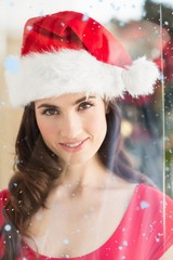 Composite image of portrait of a festive brunette at christmas