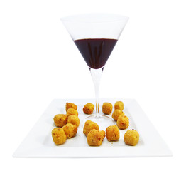 Croquettes with berry sauce
