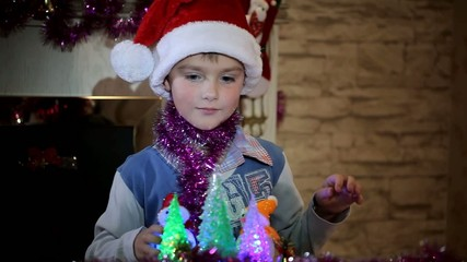 Boy playing with Christmas toys