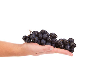 Hand holding red grape