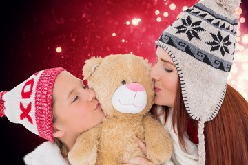 Composite image of mother and daughter kissing teddy