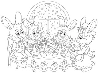 Rabbits at the holiday table with a Christmas cake