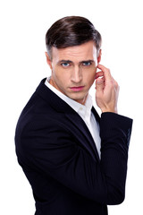 Portrait of a thoughtful businessman over white background