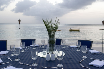 table set for dinner on the beach