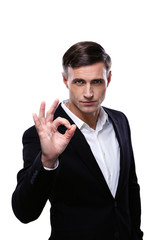 Young confident businessman over white background