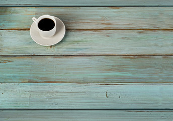 Coffee cup  on a  blue  wooden background