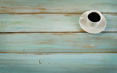 Coffee cup  on blue  wooden background