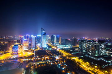 modern cityscape and traffics during night