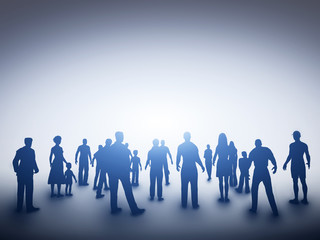 Group of various people silhouettes looking towards light