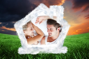 Composite image of couple relaxing in bed