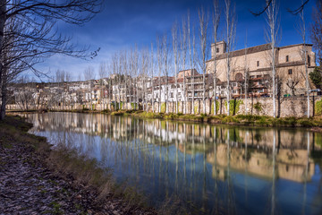 River Tajo passing through the village of Trillo. Spain