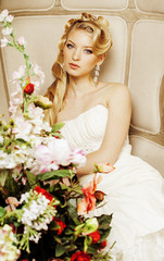 beauty young bride alone in luxury vintage interior with a lot