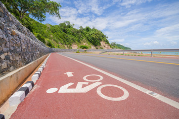 The red bike lane situated at the seaside. Chanthaburi, Thailand