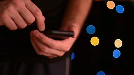 Caucasian white male hands holding smart phone device