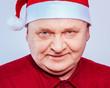 Spiteful man in Santa Claus hat
