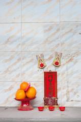 Hong Kong street shrine with fruit
